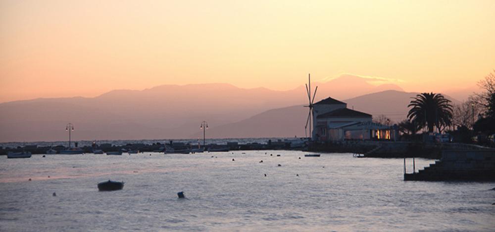 Windmill and Nautilus Cafe in Garitsa Bay